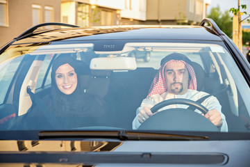 Young Arabic Couple In Car