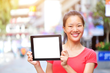 woman hands hold blank digital tablet  in modern city
