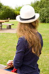 young woman with her back turned looking away.