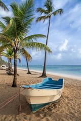 boat on sandy Tropical Caribbean beach