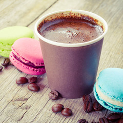macaroons and espresso coffee cup on old wooden rustic table