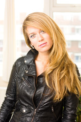 young woman wearing a leather jacket.