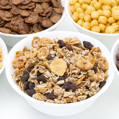 granola and various breakfast cereals in bowls