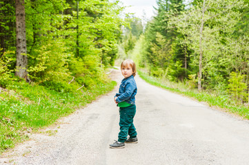 Cute toddler boy in a forest