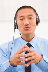 Close-up of male customer service representative wearing headset