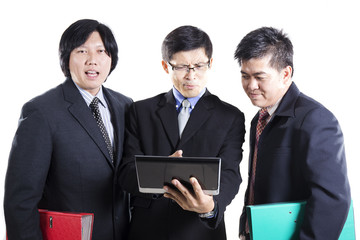 Three Businessman meeting and using Tablet
