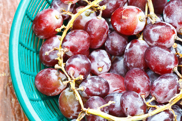 red grapes in basket on a wooden background
