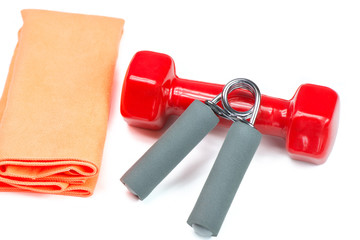 Dumbbell, hand trainer and towel, isolated