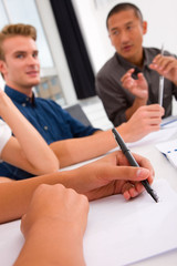 Businesswoman taking note in meeting