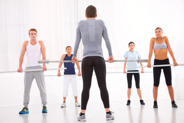 Diverse group of people exercising in gym