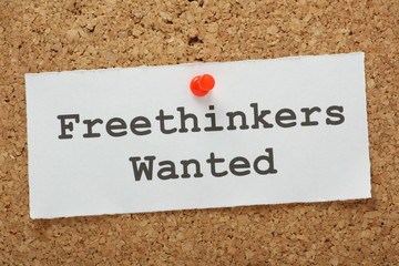 The phrase Freethinkers Wanted on a cork notice board