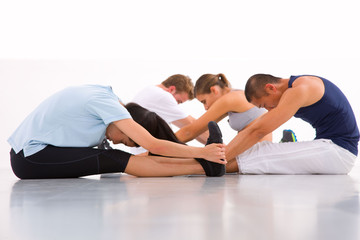 Diverse group of people doing yoga