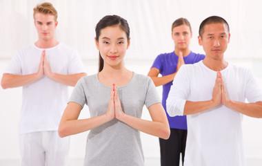 Multi ethnic group of happy people doing yoga