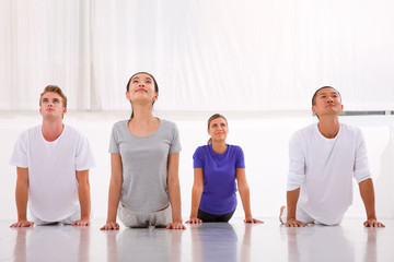 Multiethnic group of people practicing yoga