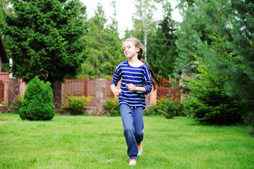 Adorable preteen girl doing exercise outdoors