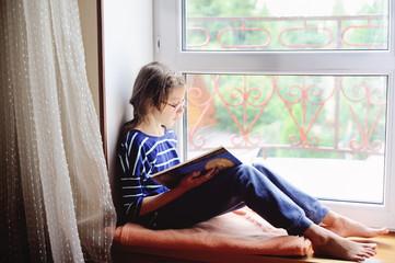 Kid girl reading book indoor