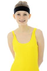 Teenager in Aerobic Dress trägt Schweissband