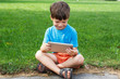 Boy smile with tablet outdoor