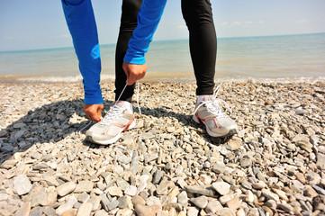 woman runner tying shoelace outdoor
