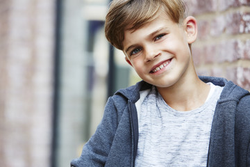 Portrait of young boy smiling.