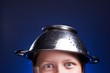 Girl with a colander on her head