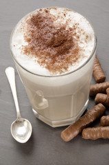milk coffee with cocoa powder in a glass