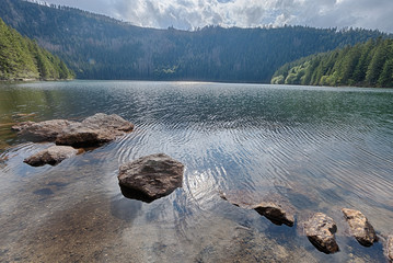 Glacial Black Lake surrounded by the forest