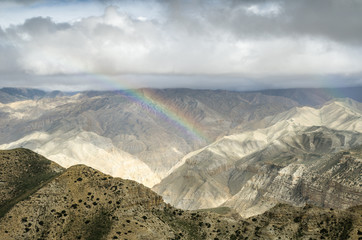 Colorful rainbow in the Nepalese mountains after the rain