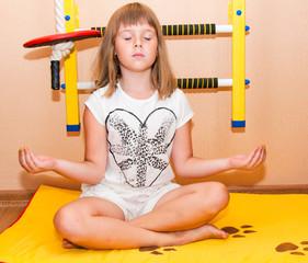 Girl meditates near home sport complex