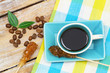 Black coffee in vintage cup, sugar sticks and coffee beans