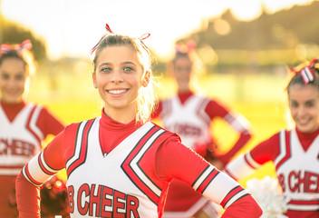 Portrait of happy young cheerleader in action - Sport outdoors