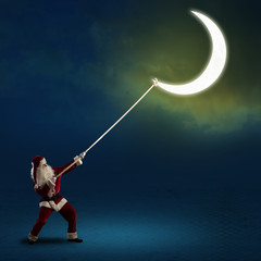 Santa Claus pulls the moon