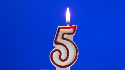 Number 5 - five birthday candle burning