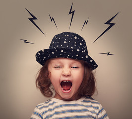 Angry shouting kid with lightnings above the head on grey
