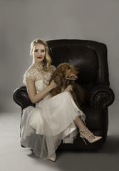 Beautiful woman on couch with dog on her lap