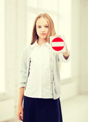 girl showing stop sign