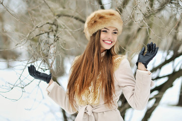 Beautiful smiling winter girl - outdoor portrait