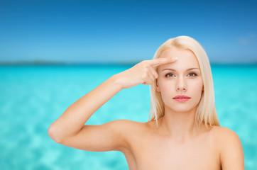 beautiful woman touching her forehead