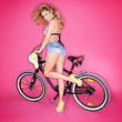 Sexy blond woman with a bicycle