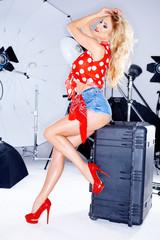 Sexy elegant model in a studio photo shoot