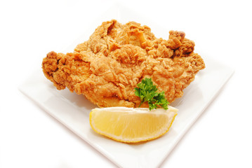 Served Fried Chicken with a Lemon Wedge