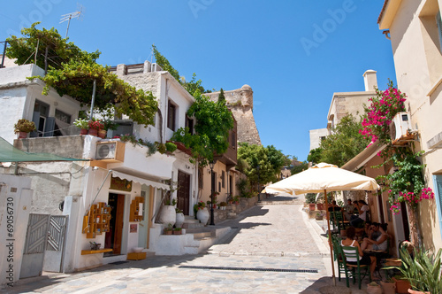Tourists have a rest in a restaurant in Rethymno. Crete, Greece.