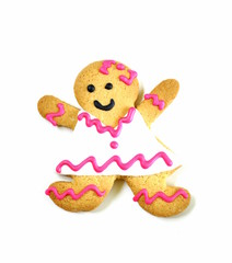gingerbread man cookies with icing on a white background