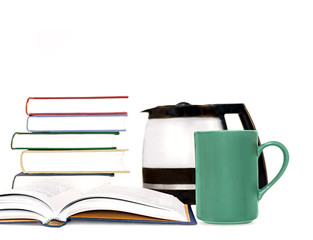 Hardcover books, coffee mug, coffeepot isolated on white