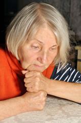 elderly woman thinks