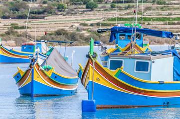 Traditional Luzzu boat at Marsaxlokk harbor in Malta.