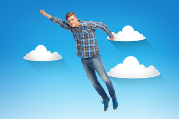 smiling young man jumping in air