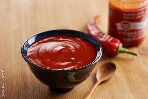 Bowl of sriracha sauce - 69059710