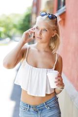 Beautiful blonde teen girl talking on the phone