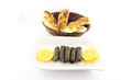 Sliced ramadan bread and stuffed grape leaves